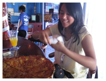 Me eating pizza at Skuba Junkie in Semporna