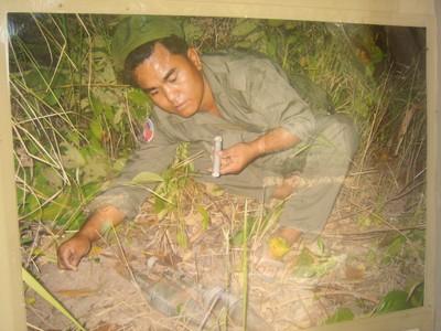Picture of Aki Ra disarming a landmine in Cambodia