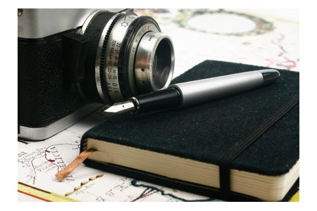 Picture of a notebook, camera and a pen, ©iStockphoto.com/oonal