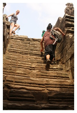 Climbing the stairs at Bayon site