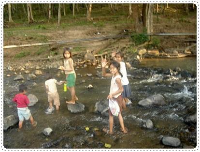 children living near tad lo waterfalls