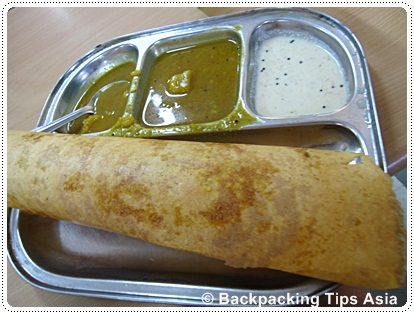 Eating out in delhi at a restaurant in Delhi, here eating masala dosa