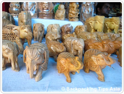 Shopping at Dilli Haat, some wooden elephants at the market