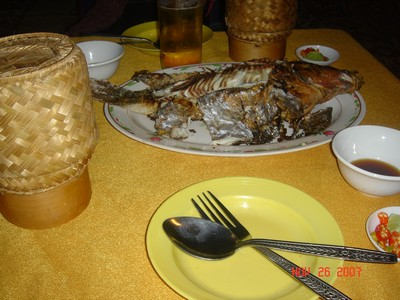 Fish dinner and sticky rice by Mekong in Vientiane