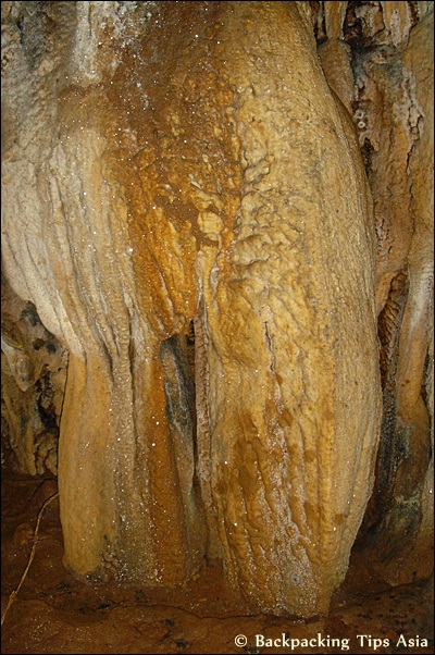 Glittery rock formations at Tham Loup cave