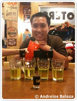 Getting ready for drinking shots at Hooters restaurant in Manila