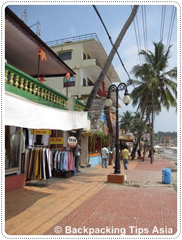 Lighthouse and shops at Kovalam beach in Kerala