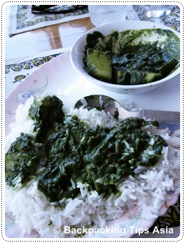 Aloo dish containing spinach and potatoes in Kovalam