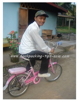 Our weaving teacher on a Kitty bike in Luang Prabang