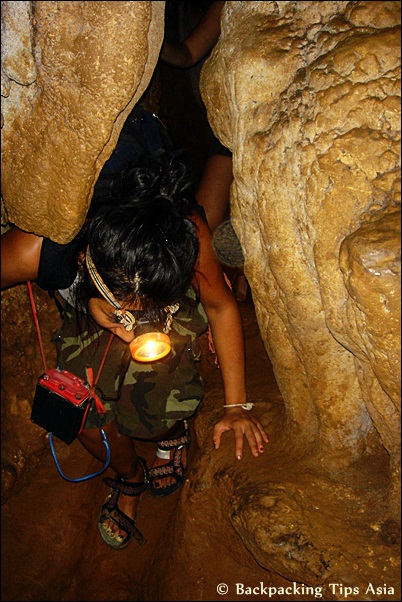 Me crawling in Tham Hoi Cave