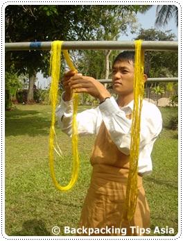 Drying silk thread at Ock Pop Tok
