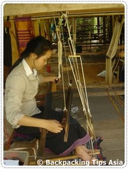 A weaver at Ock Pop Tok