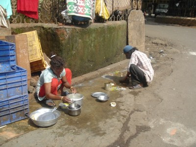 People washing the streets in Mumbai