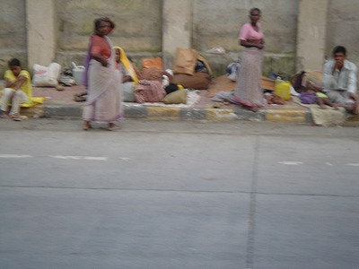 Poor people living by the highway in Mumbai, India