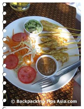 Satay chicken at a restaurant in Soi Rambuttri in Bangkok, Thailand